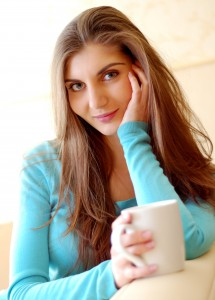 Young beautiful woman drinking tea at home